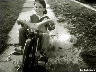 boy on big wheel