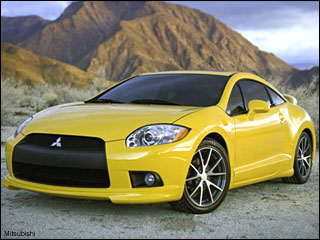 yellow Mitsubishi Eclipse coupe