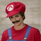 Look at Penlope Cruz all dolled up (as Mario) in this ad [Video]
