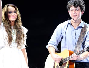 nick jonas miley cyrus wedding bells