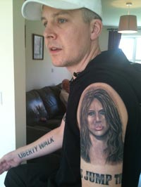 man with 15 Miley Cyrus Tattoos