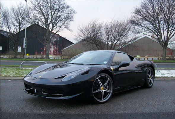 A one-of-a-kind Ferrari worth around 230,000 has been stolen in a daring robbery from a Surrey Dealership