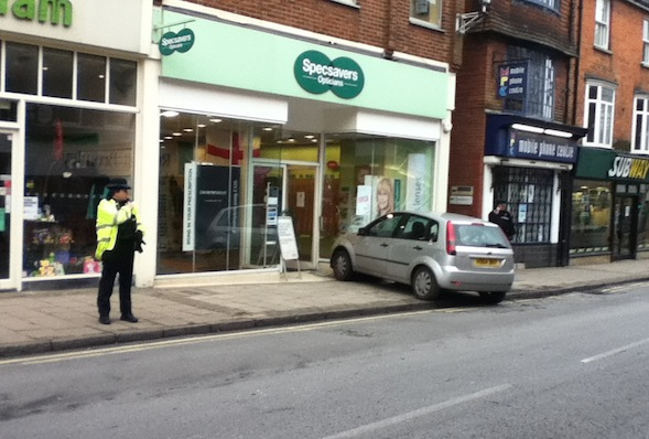 Time for an eye test? Car crashes into Specsavers