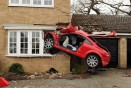 Serious crash sees car embedded into side of house