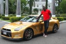 Usain Bolt takes delivery of his gold Nissan GT-R