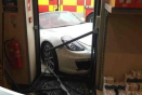 Porsche driver crashes into Aldi store