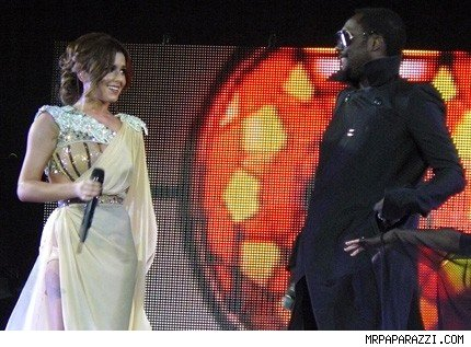Cheryl Cole and Will.I.Am on stage