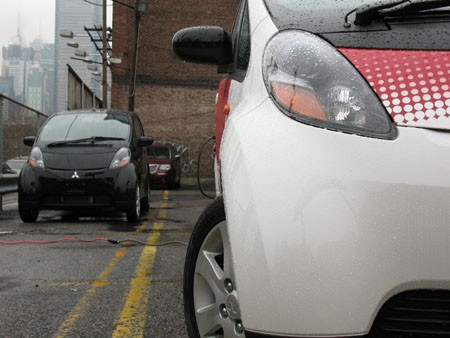 Foreground: Mitsubishi i MiEV, Background: Mitsubishi i Turbo