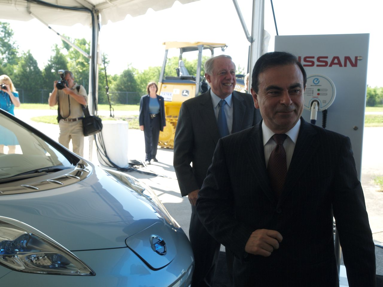 Carlos Ghosn with 2011 Nissan Leaf