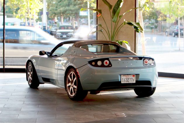 tesla roadster in retail store