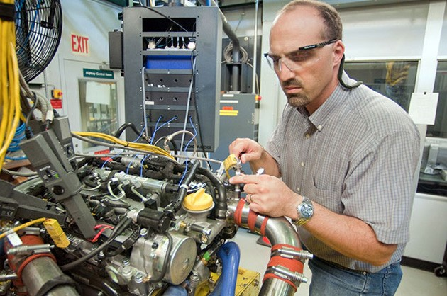 Steve Ciatti working on a diesel engine that burns gasoline