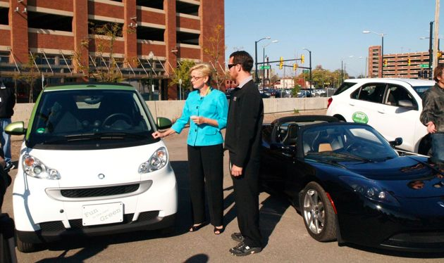 jennifer granholm with the smart ed and tesla roadster