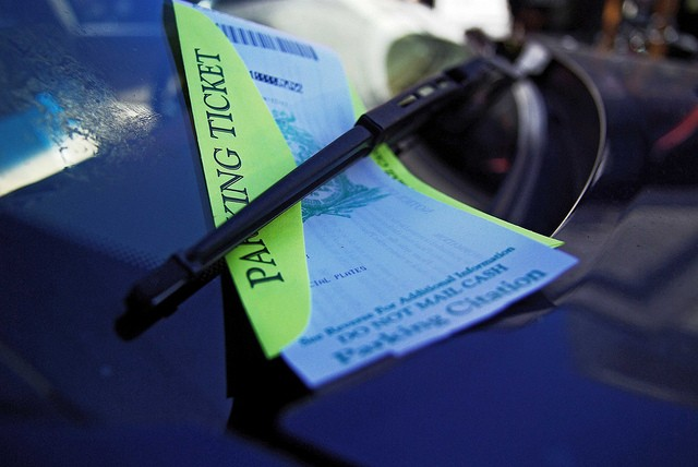 Parking ticket on window of car