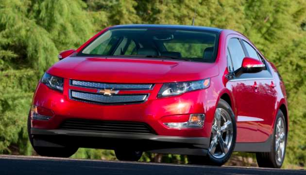 red chevy volt against trees