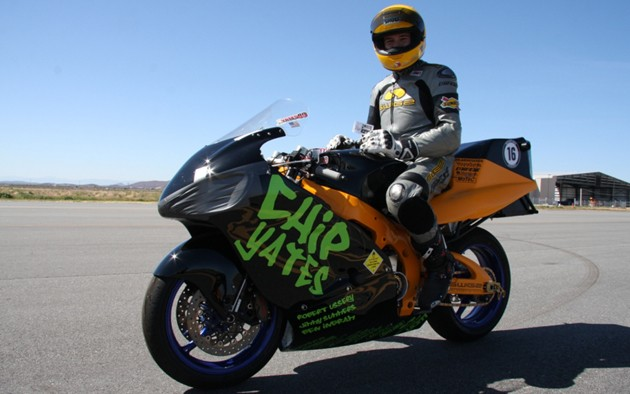 Chip Yates sits on his electric superbike at the Mohave Mile Shootout
