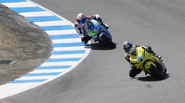 Lightning Motors leads MotoCzysz bike through corkscrew at Laguna Seca