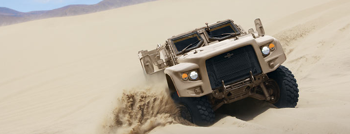 Oshkosh Defense L-ATV climbing sand dunes