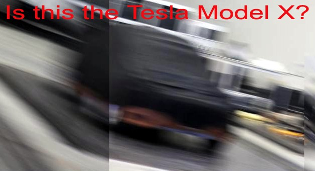 Blurry spy shot of possible Tesla Model X clay model mostly under black tarp