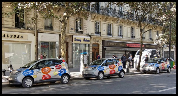 Three Bollore Bluecars belonging to the Parisian car-sharing service Autolib wait curbside