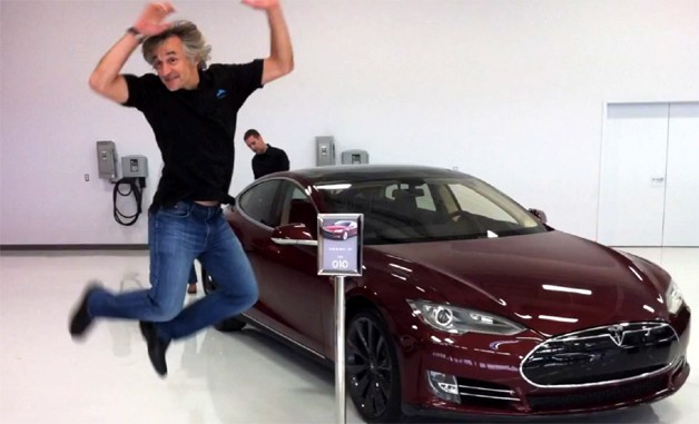 Tesla Model S with owner Konstantin Othmer jumping for joy