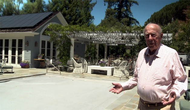 George Shultz shows his house with solar panels.
