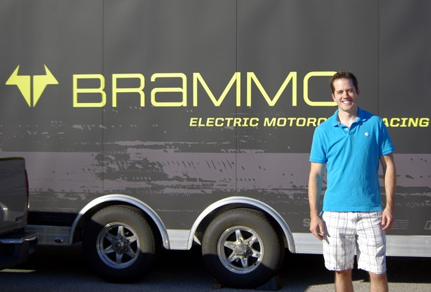 Jeremy Dory, Brammo brand evangelist of the year, stands in front of Brammo-branded race support trailer