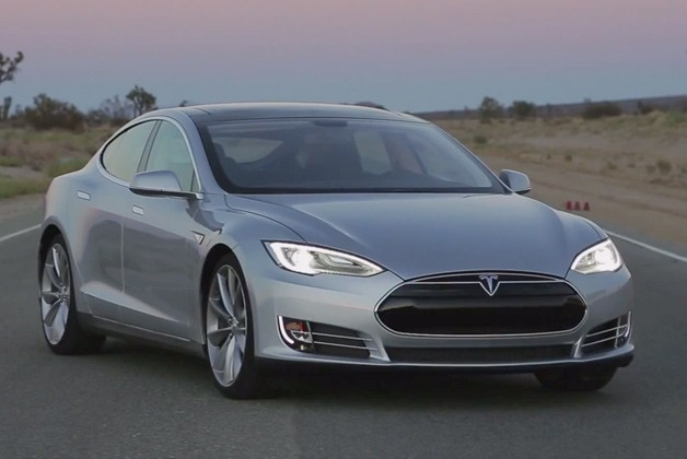2013 Tesla Model S in silver - front three-quarter view. Motor Trend Ignition video screencap.