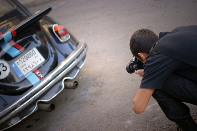 photographer with car exhaust
