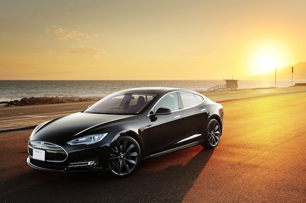 Tesla Model S with sun and beach