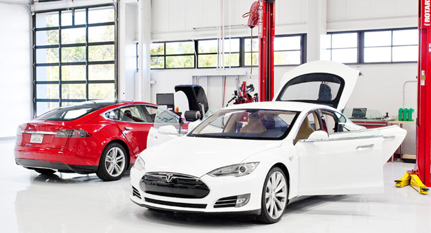 Tesla Motors service bay with Model S in red and white