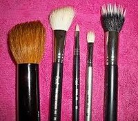 makeup brushes on towel