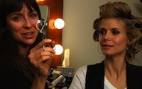 Sabrina Bedrani showing Heidi an eyelash curler