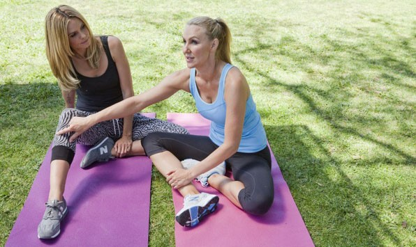 Heidi Klum and Andrea Orbeck stretching