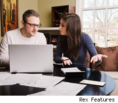 Young couple stressed about finances
