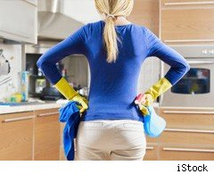 Woman in kitchen with cleaning products