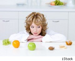 Woman contemplating diet