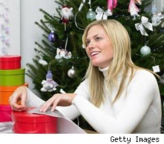 Woman wrapping xmas presents