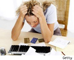 Stressed woman with credit cards