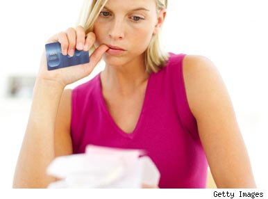 Woman worried holding credit card