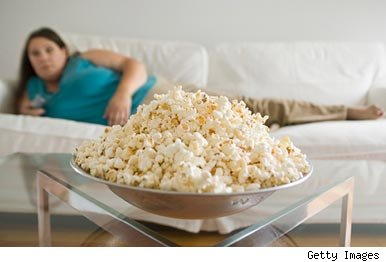 Woman on sofa popcorn