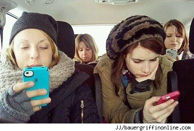 Girls looking at mobile phones