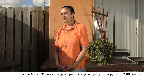 Janice Doble, 50, wore orange as part of a group going to happy hour. ZUMAPress.com