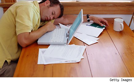 How to deal with your dead-end job: Worker sleeps at his laptop.
