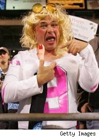 A Cowboys hating Panthers fan wears a Jessica Simpson costume 