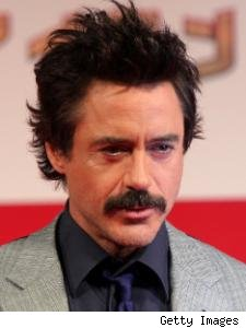 A mustache clad Robert Downey Jr. at the Japanese premiere of Iron Man