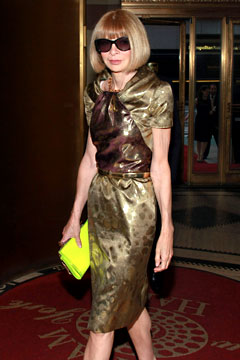 anna wintour with neon clutch