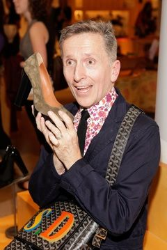 Simon Doonan hawking shoes at Fashion's Night Out.