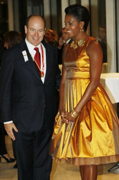Michelle Obama in gold dress with prince albert