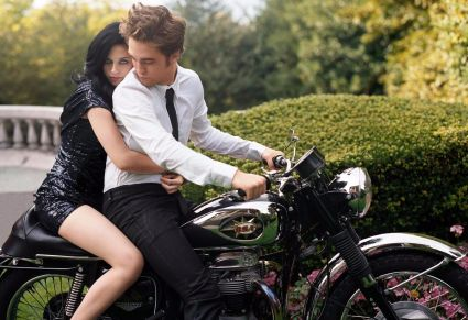 Kristen Stewart in Alexander McQueen on Robert Pattison's bike