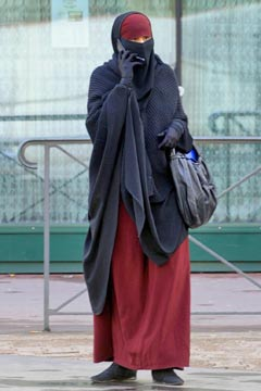 Woman in Burqa on cell phone partial ban france